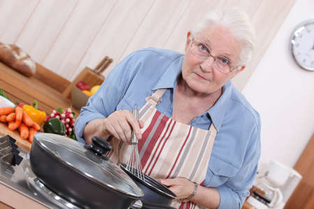 Elderly woman cooking Stock Photo - 14204026