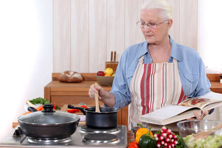 Old woman cooking Stock Photo - 14204082