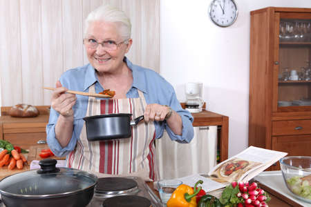 oap: Older woman cooking a meal