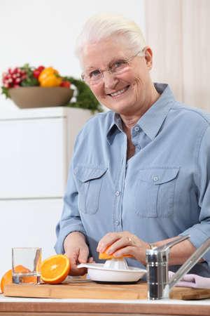 Woman juicing an orange photo
