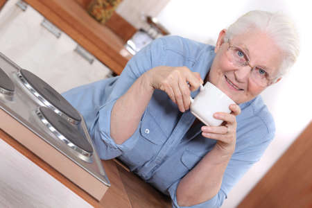 Senior woman enjoying a cup of tea photo