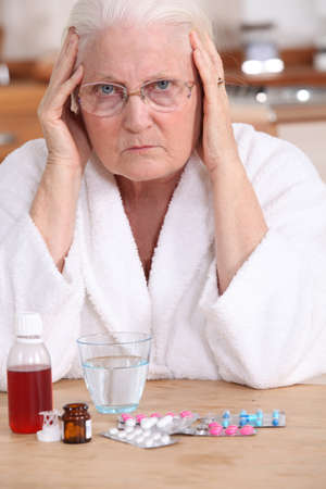 grouch: Bitter woman in front of her medication Stock Photo