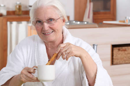 senior woman having breakfast photo