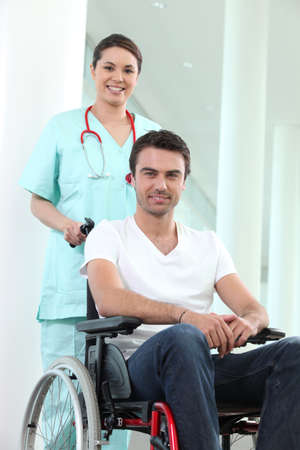 satisfactory: Nurse with disabled man in a wheelchair