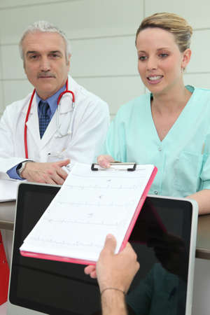 Nurse by collecting medical report photo