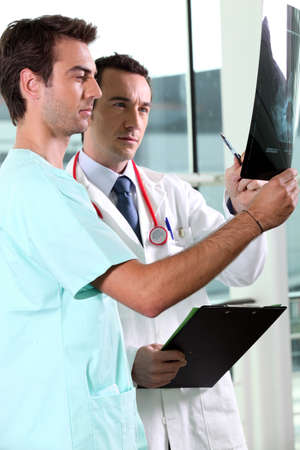 Two doctors examining x-ray image photo