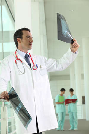 Hospital doctor looking at an xray photo
