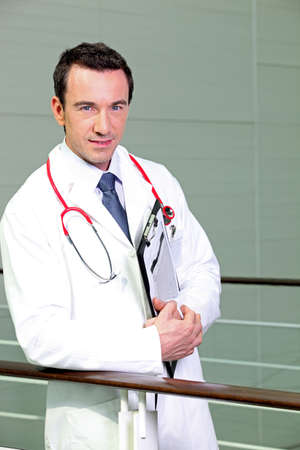 Doctor leaning against railing photo