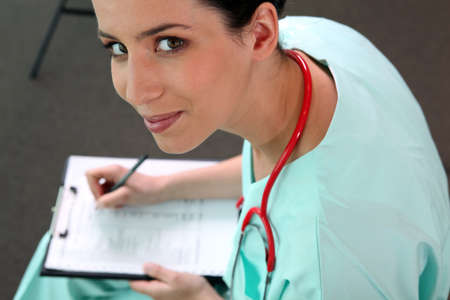 hospital staff: Female doctor with clipboard