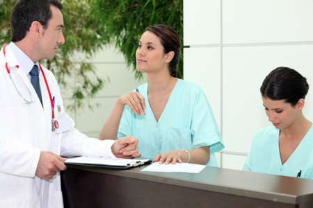 Doctor in the hospital reception Stock Photo - 14207615