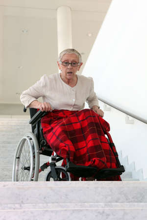 the elderly residence: Disabled woman in front of stairs Stock Photo