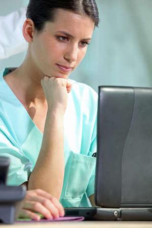 Female nurse with laptop photo