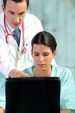 ail: a doctor and a nurse working Stock Photo