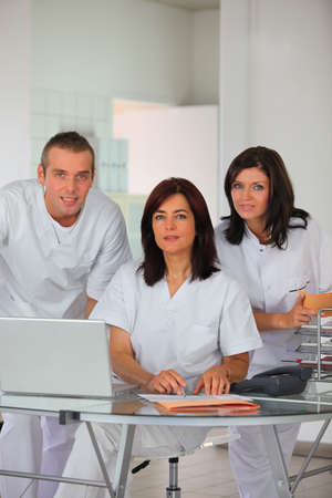 medical practice: Dental team at a laptop Stock Photo