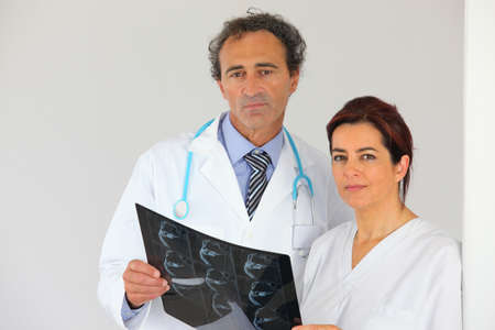forbidding: Doctors looking at an x-ray