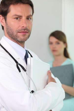 public private: Hospital doctor with a laptop