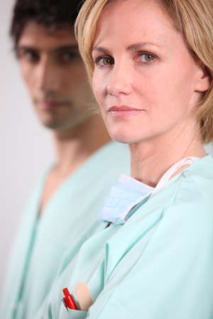 Blond nurse stood with male colleague photo