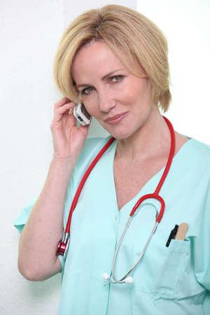 Hospital medic using a cellphone photo