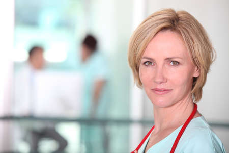trained nurse: Blond female doctor