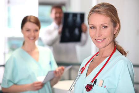 Female nurse in X-ray room. Stock Photo - 14206627