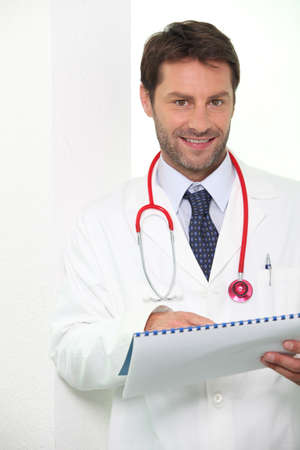 Young doctor with a report photo