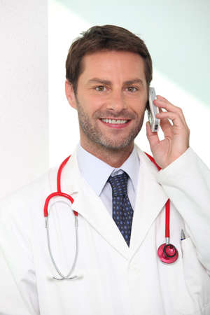 portrait of a doctor on the phone Stock Photo - 14207772