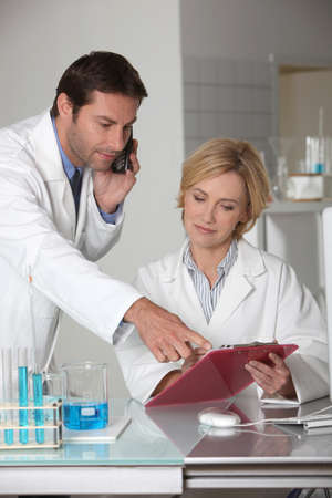 glasswear: Man and woman working in a laboratory Stock Photo