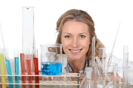 analytical chemistry: Woman with a variety of laboratory equipment