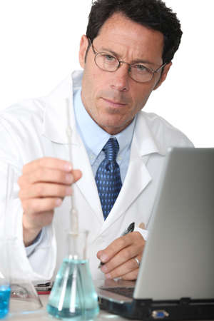 Lab technician analyzing test results photo