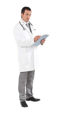 Doctor writing on clipboard photo