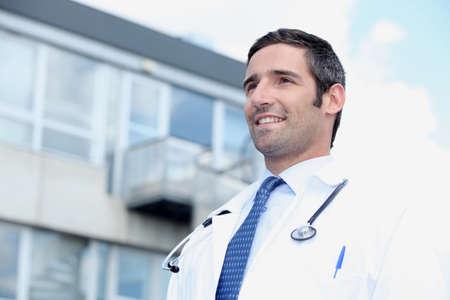 taking a break: Doctor standing outside
