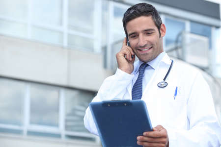 Young doctor stood outside hospital photo