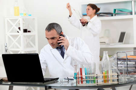 A pair of scientists conducting an experiment Stock Photo - 14205387