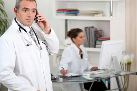 Two medical workers in clinic reception Stock Photo - 14206927