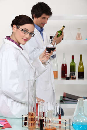Oenologists analysing wine photo
