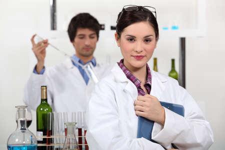 wine testing: Man and woman testing wine in laboratory