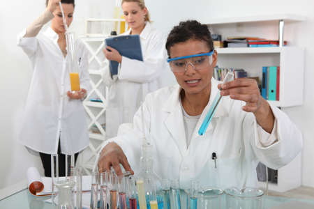 pharmacology: female trio in lab with test-tubes