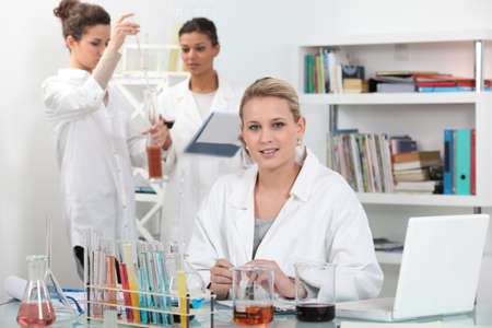 analytical: A group of scientists carrying out experiments