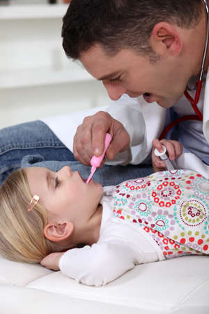 Doctor checking little girls temperature Stock Photo - 14206963