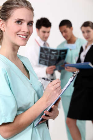 Medical team with a clipboard Stock Photo - 14207673