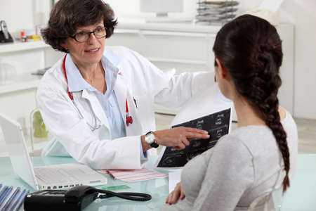 gynecologist: Female doctor with patient Stock Photo