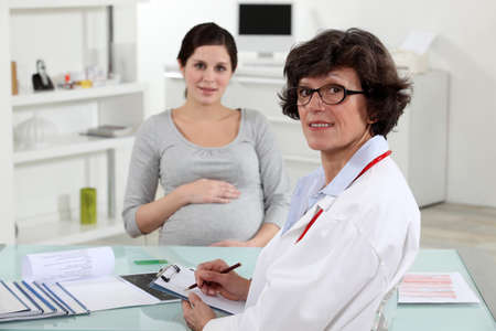 pregnant woman and in obstetricians surgery