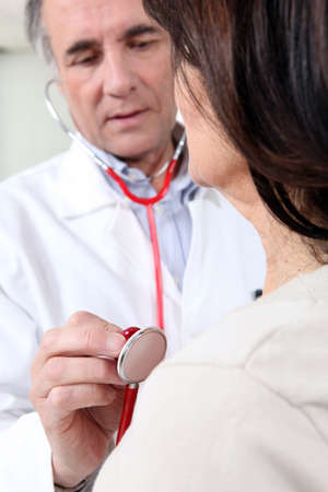 osteo: Woman in check-up with doctor Stock Photo