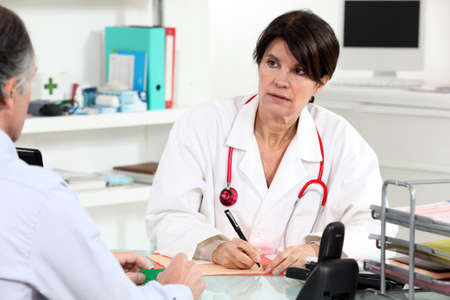 knowledgeable: Doctor consulting with a patient