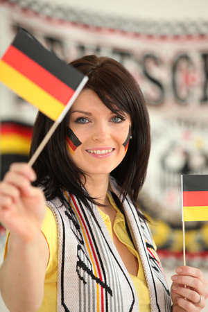 supporter: Germany supporter holding miniature flags