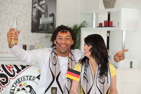 German couple celebrating win photo