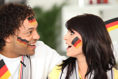 German couple happy with teams performance photo