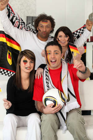 A group of friends supporting the German football team photo