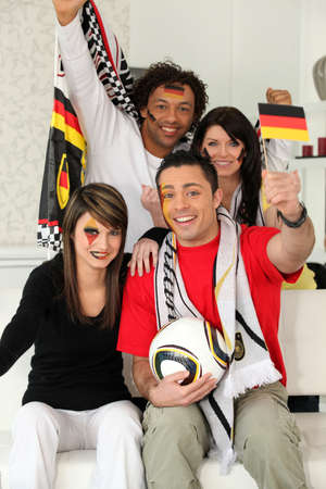 Group of friends supporting the German football team Stock Photo - 14208110