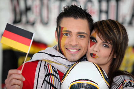 Couple supporting German football team photo